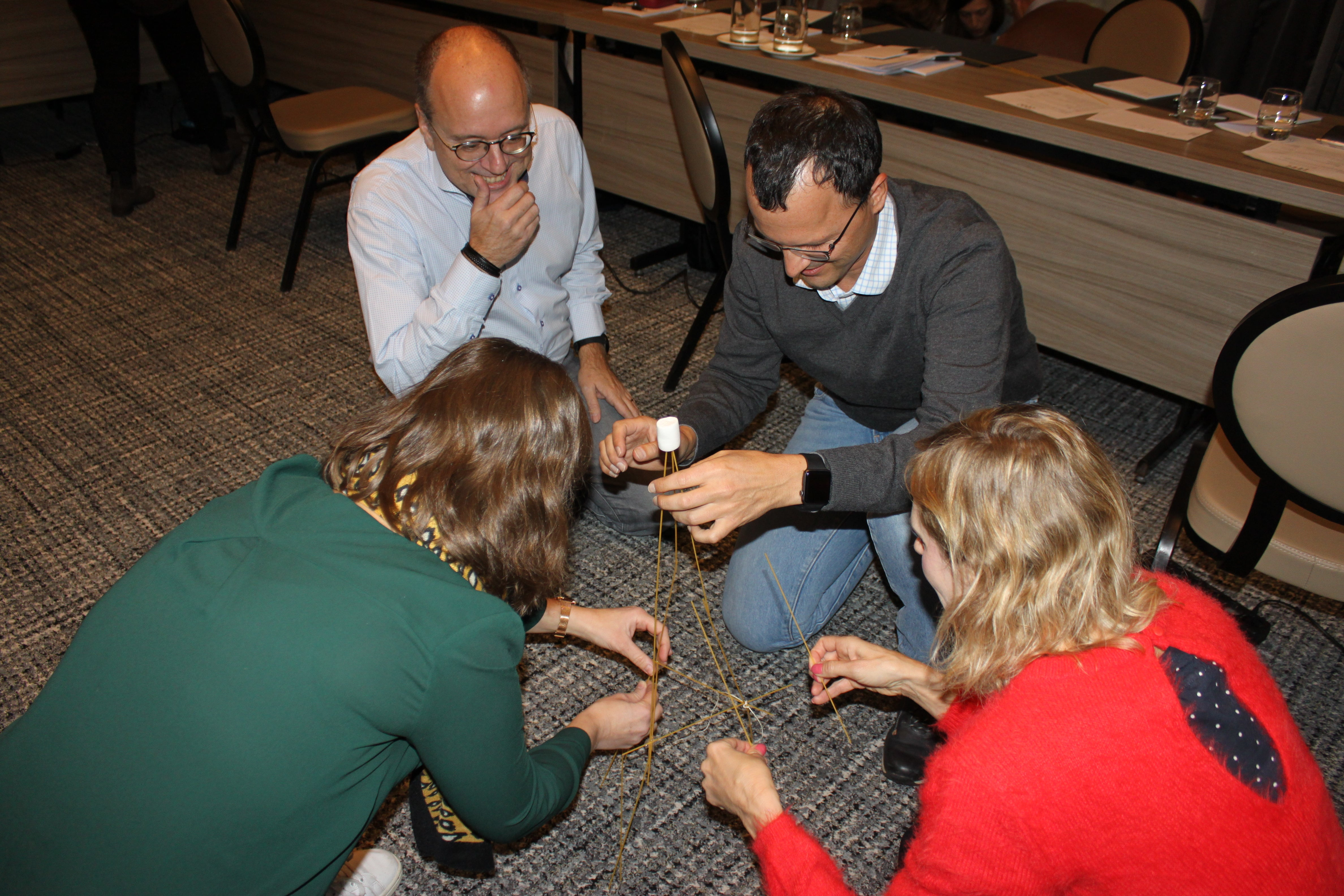 Team building at kick-off meeting: building the highest spaghetti tower.