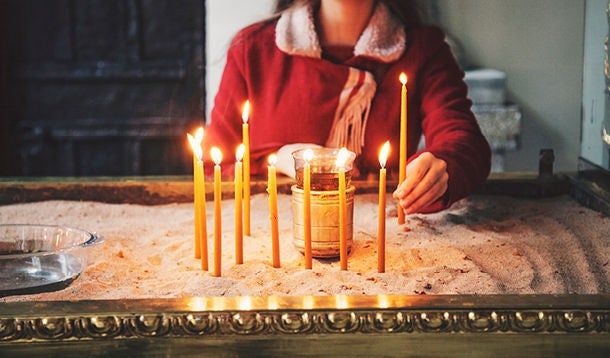 Woman lights candles
