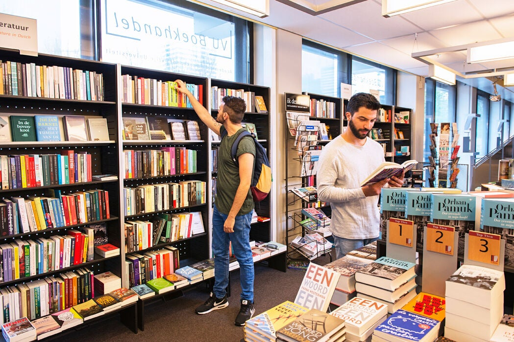 Two male students in the VU bookstore
