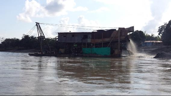 boat for goldmining on river