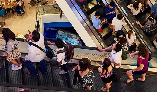 Several escalators with people