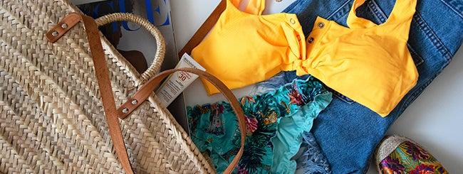 Yellow bikini, sunscreen, bag, jeans short ready for the beach