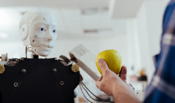 Human shows apple to robot